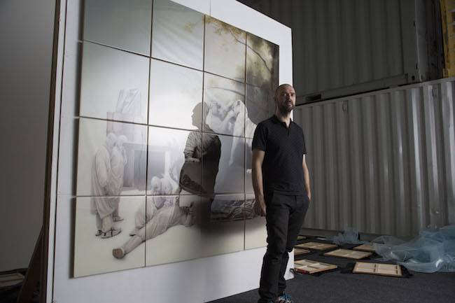 Sam Leach in his studio with work for Crossing Borders, Palazzo Bembo, Venice Biennale 2015